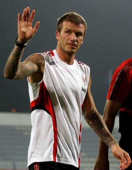 Image comment: Heavily tattooed David Beckham says one of his boys also