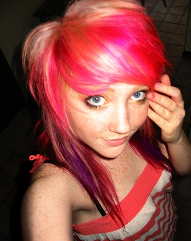 I wish I could dye my hair. Id love to have hot pink in it.