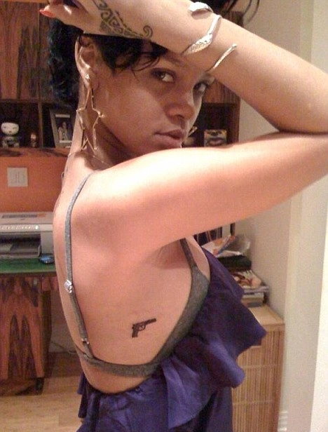 Image comment: Rihanna gets new handgun tattoo. Image credits: BangBang